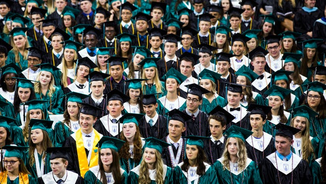 Graduates listen as their fellow students speak on Friday, May 26, 2017 during the Gulf Coast High School commencement for the class of 2017 at Alico Arena in Estero.