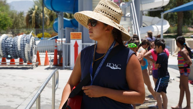 Lifeguard Alex Espinosa wears a large hat and sunglasses while working at the Palm Desert Aquatic Center June 6, 2017.