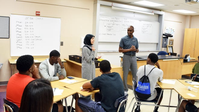 Ben Edmondson, superintendent of Ypsilanti Community Schools, talks with students in a classroom earlier this year.