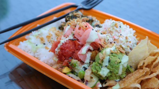 Haus of Poke in Rancho Mirage, serves poke bowls that customers put together with rice, raw fish and a selection of toppings, July 12, 2017.