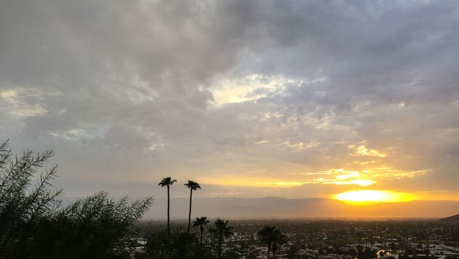 Rain clouds fill the sky over Palm Springs at sunrise on Monday morning, July 24, 2017.