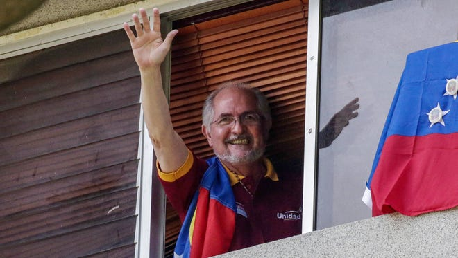 Antonio Ledezma, former mayor of Caracas, Venezuela, waves from a window of his residence on July 16, 2017. He is one of the Venezuelan opposition leaders arrested Aug. 1, 2017, after the controversial vote that will give President Nicolas Maduro more power.