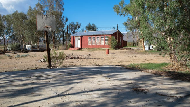 A basketball court sits next to the old schoolhouse in Nipton, Calif., which was recently sold to American Green a cannabis investment firm, Wednesday, August 2, 2017.