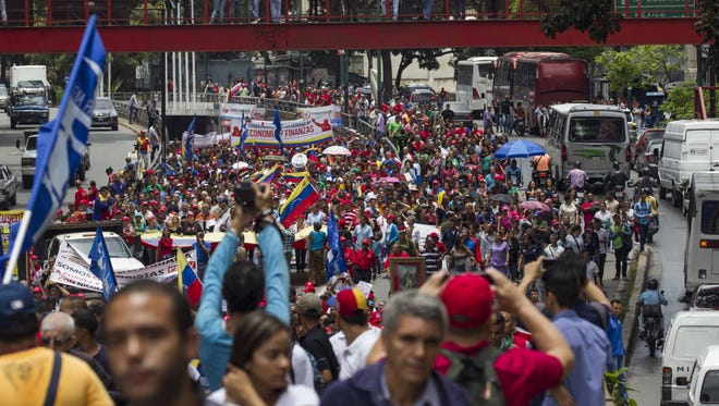 People participate during an 'anti-imperialist' march in Caracas, Venezuela, on August 14, 2017.