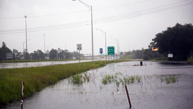 Water begins to pool in ditches near exit 101 of I-75 on Sunday, September 10, 2017 as winds begin to pick up from Hurricane Irma.