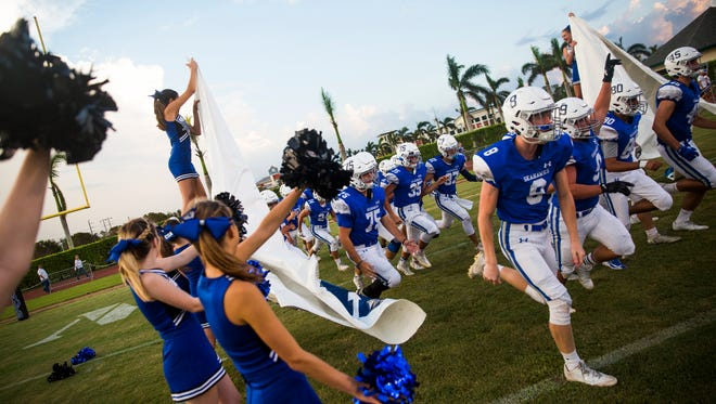 The Community School of Naples varsity football team runs onto the field for a game last September. Because of Hurricane Irma shortening its 2017 regular season, then not playing a spring game or preseason game, the Seahawks have played one quarter -- last week's weather-shortened rout of Marco Island Academy -- since the end of the 2017 season.