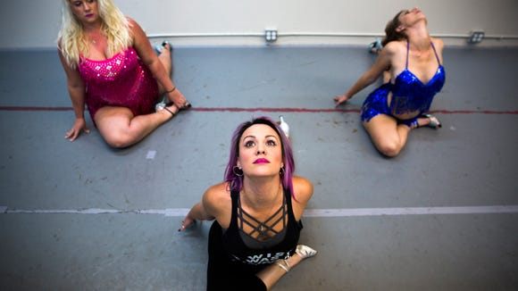 Dahlia Weston, from left, Kelly Rivadulla and Katie Vance participate in a group stretch before rehearsal on Sunday, Nov. 5, 2017, at the Flanagan O'Hare dance studio in North Naples.