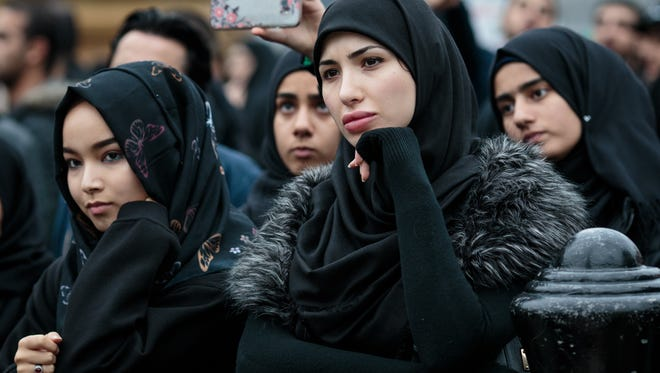 People listen to a speaker in Trafalgar Square following the annual Ashura march on Oct. 1, 2017 in London. Ashura is a Muslim festival of remembrance that falls on the tenth day of Muharram in the Islamic calendar.