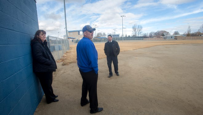 Bloomfield Supeintendent Kim Mizell, left, Bloomfield High School athletic director Cecil Linnens and Bloomfield Director of Data, Operations and Assessment James Olivas talk about the old softball field on Wednesday during a tour at Bloomfield High School.