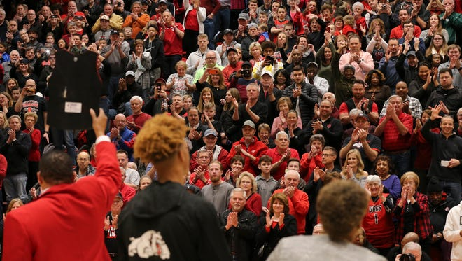 New Albany's Romeo Langford (1) was joined by his parents Tim Langford, left, and and Sabrina Langford on senior night before their game against Bedford North Lawrence at New Albany High School.  It is Langford's last home game.  His dad was holding up his jersey number as the crowd cheered them.Feb. 16, 2018