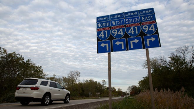 Signs for Interstates 41 and 94 can be seen along County Line Road on Oct. 26, 2017, in Mount Pleasant. Foxconn's new 20 million-square-foot manufacturing plant will be built in Mount Pleasant.