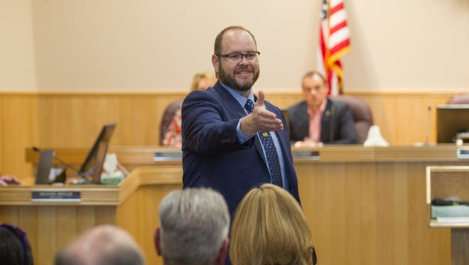 Nate Duckett recognizes guests on Monday during his swearing-in ceremony as mayor in the Farmington City Council chambers.