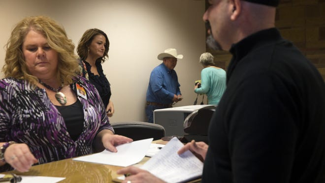 San Juan County Clerk Tanya Shelby, left, and members of her staff process filing paperwork for public office seekers on Tuesday in at the San Juan County Clerk's Office in Aztec.
