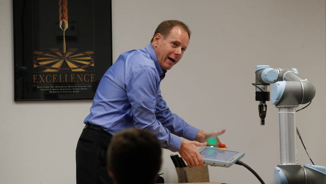Chris Ziomek, managing partner with Build with Robots, delivers a presentation on Tuesday at the San Juan College Quality Center for Business in Farmington.
