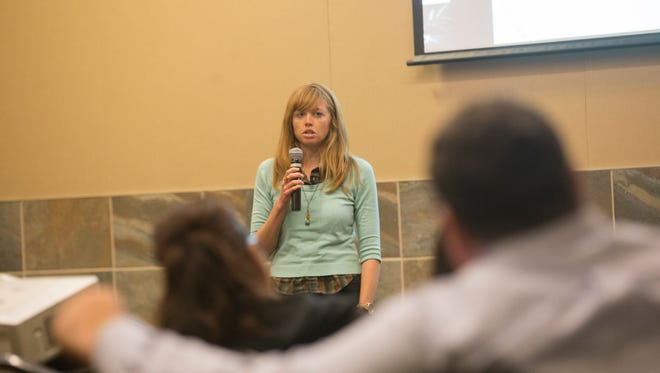Attorney Cassie Fleming of New Mexico Legal Aid gives a presentation on small loans Wednesday during a seminar at the Farmington Civic Center.
