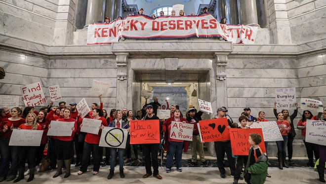 Hundreds of teachers from school districts around Kentucky rallied in Frankfort on Friday morning after pension reform legislation was pushed through on Thursday night.