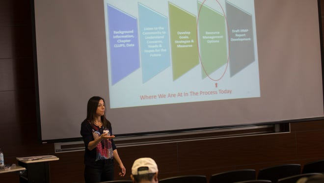 Melissa Antol, community coordinator with Revolution Advisors, talks about the Navajo Forestlands Integrated Resource Management Plan during a community meeting Thursday at the John Pinto Library at Diné College in Shiprock.