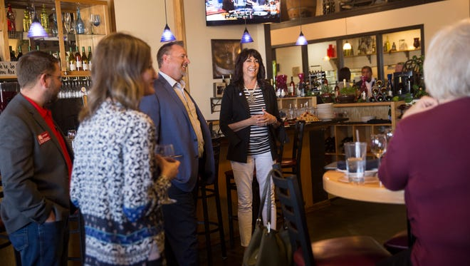 Michelle Garcia Holmes, right, a Republican candidate for lieutenant governor, meets with local Republican Party members on Thursday at St. Clair Bistro in Farmington.