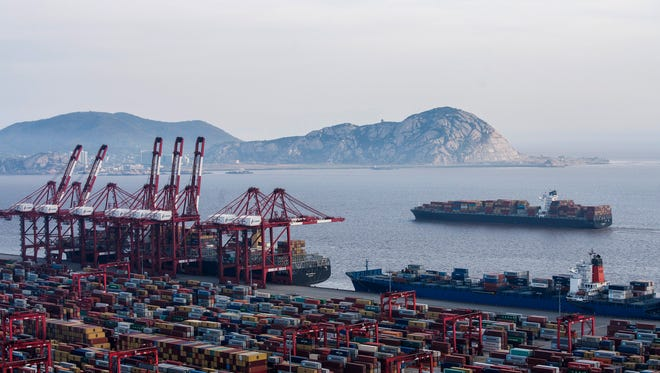 In this March 29 photo, a container ship is docked at the Yangshan port in Shanghai. President Donald Trump has instructed the U.S. trade representative to consider slapping an additional $100 billion in tariffs on Chinese goods in a dramatic escalation of the trade dispute between the countries.