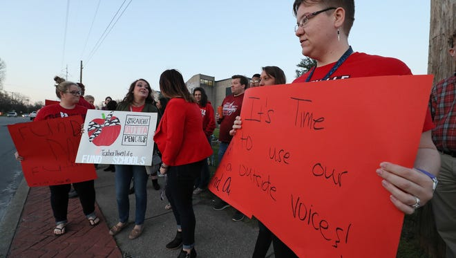 Sarah Hodge, who teaches Freshman English at Southern High School, participates in a rally and walk-in at the school on Thursday morning.April 12, 2018
