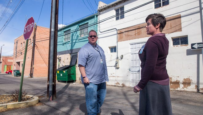 Farmington downtown coordinator Michael Bulloch and Sherry Roach, project coordinator for the Complete Streets program, survey a downtown alley on March 19 while talking about the Art in the Alley project.