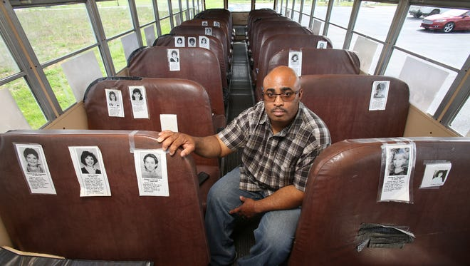 Quinton Higgins, 45, was 15-years-old when he and other passengers were the victims of a bus crash in Carrollton, Ky. which resulted in the deaths of 27 people.  He has purchased a replica of the bus they were riding in and turned it into a mobile memorial.  He has placed photos of the victims in the seats they occupied during the crash.  He is now a school bus driver as well.