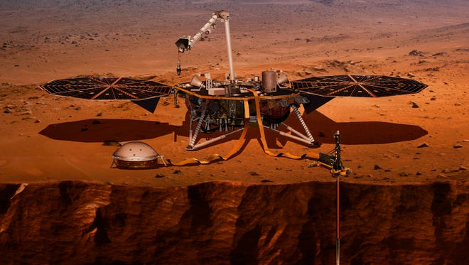 This illustration shows the InSight lander drilling into Mars.