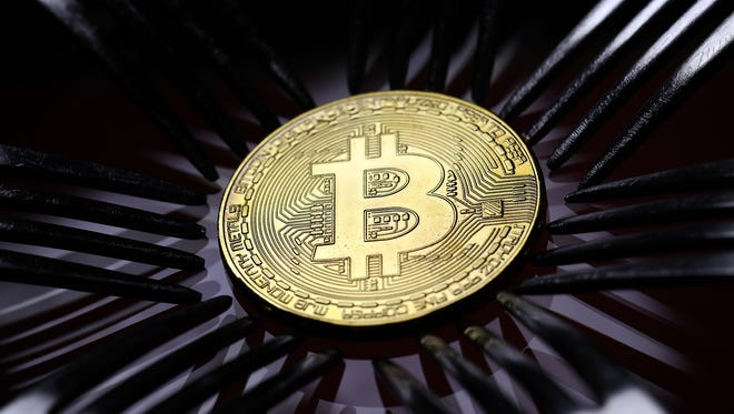 A visual representation of the digital currency bitcoin that uses the so-called blockchain technology.