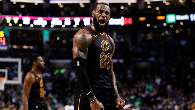 Cleveland Cavaliers forward LeBron James (23) celebrates after drawing foul against the Boston Celtics during the fourth quarter in game seven of the Eastern conference finals of the 2018 NBA Playoffs at TD Garden.