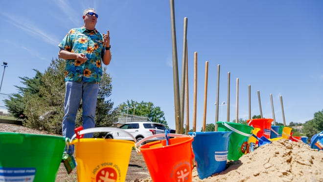 Cory Styron, director of the Farmington Parks, Recreation and Cultural Affairs department speaks Thursday during a groundbreaking ceremony for the Brookside Bay Water Park in Farmington.