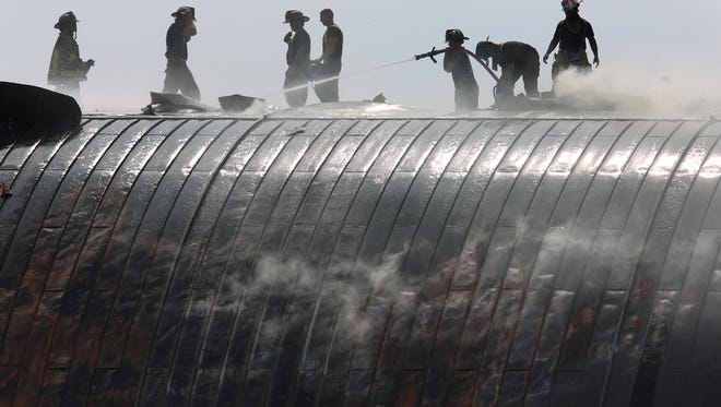 Firefighters used the roof of The Kentucky Center for the Performing Arts to battle a fire. June 13, 2018