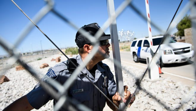 A security officer closes a gate to the Tornillo Port of Entry as mayors and others try and enter to visit with immigrant minors who are housed there June 21, 2018 in Tornillo, Texas.