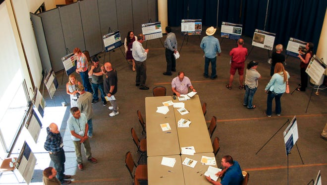Community members participate in a public comment meeting for the San Juan Mine Deep Lease Extension Tuesday at the Farmington Civic Center.
