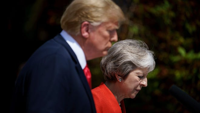 """US President Donald Trump (L) and Britain's Prime Minister Theresa May  hold a joint press conference following their meeting at Chequers, the prime minister's country residence, near Ellesborough, northwest of London on July 13, 2018 on the second day of Trump's UK visit. Britain and the United States have agreed to pursue """"an ambitious UK-US free trade agreement"""" after Brexit, Prime Minister Theresa May said on Friday following talks with US President Donald Trump. / AFP PHOTO / Brendan SmialowskiBRENDAN SMIALOWSKI/AFP/Getty Images ORIG FILE ID: AFP_17K6L8"""