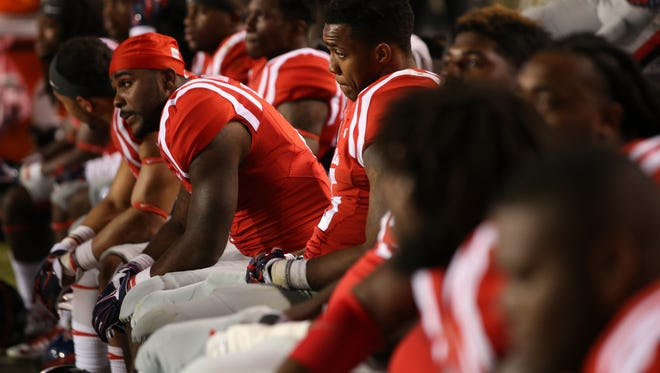 BATON ROUGE, LA - OCTOBER 25:  Members of the Mississippi Rebels watch the last few minutes of a 10-7 loss to LSU Tigers at Tiger Stadium on October 25, 2014 in Baton Rouge, Louisiana.  (Photo by Chris Graythen/Getty Images)