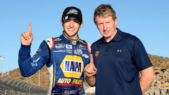 Chase Elliott celebrates with his Hall of Fame father Bill Elliott at Phoenix International Raceway.