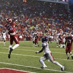 Arkansas safety Rohan Gaines (26) intercepts a pass last season during the second half against the Ole Miss Rebels at Donald W. Reynolds Razorback Stadium.