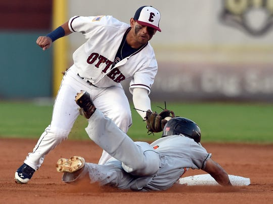 Christopher Riopedre of the Otters tags out Alfredo Rodriguez the Joliet Slammers on the attempted steal at second base during the first inning of game one of the Frontier League Divisional series at Bosse Field in Evansville Tuesday.
