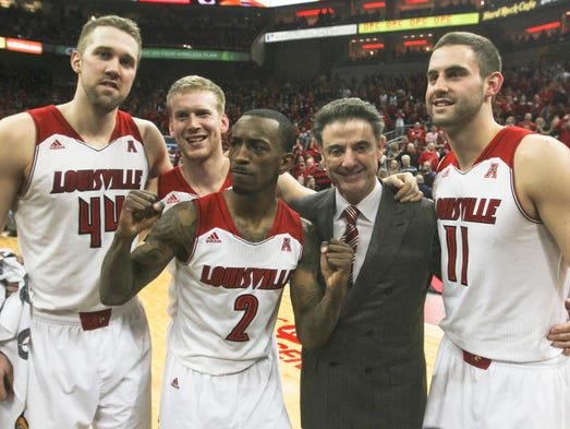 Louisville head coach Rick Pitino and his seniors Stephan Van Treese, Tim Henderson, Russ Smith and Luke Hancock at the KFC Yum! Center. March 8, 2014.