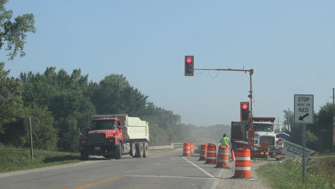 Work began Monday, July 30, on a bridge re-decking project on M Avenue north of Marengo. This bridge crosses the Iowa River.