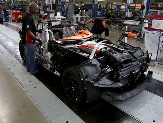 A 2015 Dodge Viper is worked on the line on Friday,