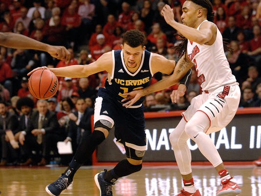 UC Irvine guard Luke Nelson (10) drives on Illinois State guard Tony Wills during an NCAA college basketball game in the first round of the NIT on Wednesday, March 15, 2017, in Normal, Ill. (David Proeber/The Pantagraph via AP)