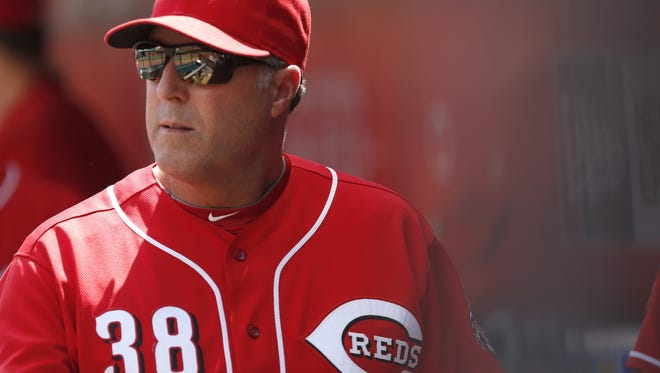 Cincinnati Reds manager Bryan Price watches from the dugout against the Los Angeles Dodgers during the sixth inning at Great American Ball Park.