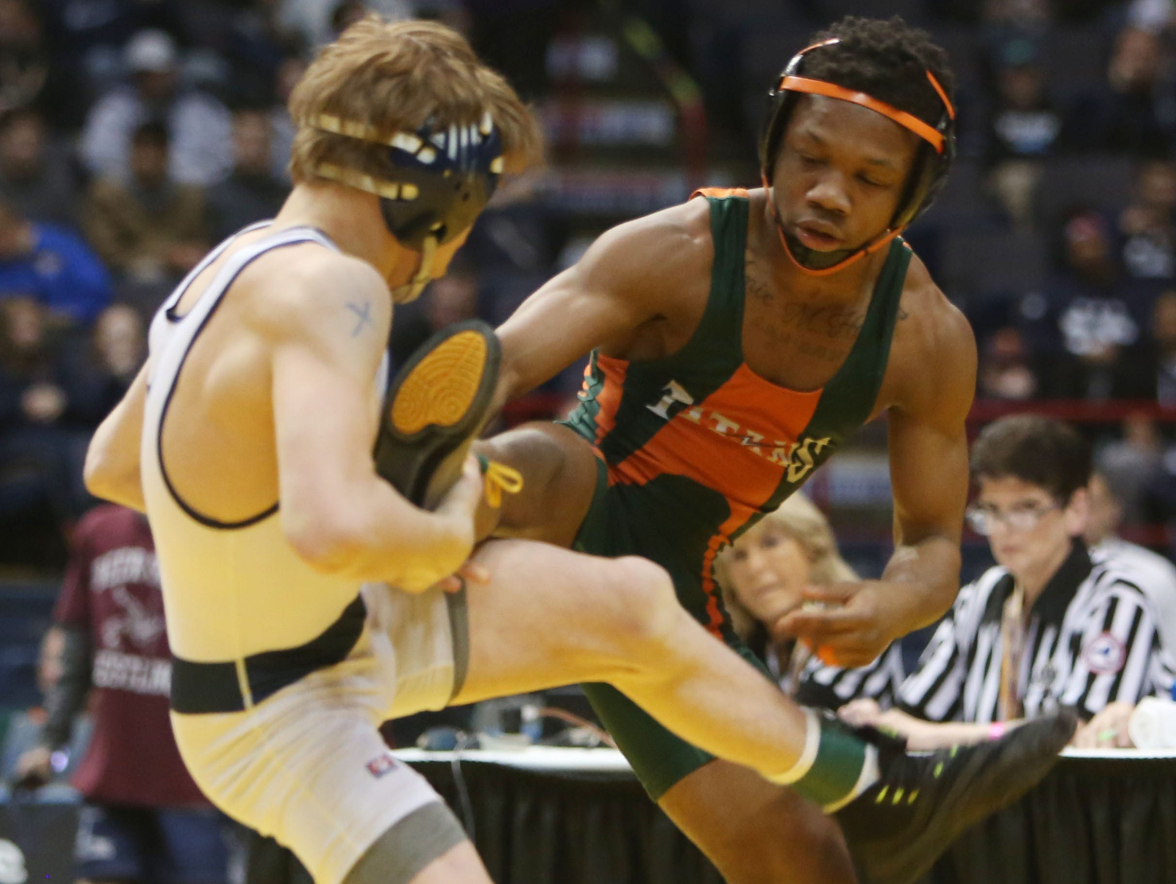 East Ramapo's Trey Wardlaw and Eastport South Manor's Adam Busiello wrestle in the 106-pound weight class in the finals of the New York State wrestling championship at the Times Union Center in Albany Feb. 27, 2016. Busiello won the match.