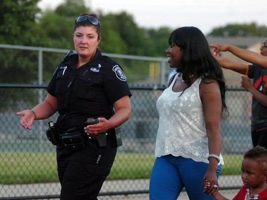 Farmington Hills Police Officer Lindsey South and Angel Livas chat while walking along the track.