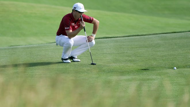 Jun 15, 2017; Erin, WI, USA;  Zach Johnson lines up his putt on the 11th during the first round of the U.S. Open golf tournament at Erin Hills. Mandatory Credit: Geoff Burke-USA TODAY Sports
