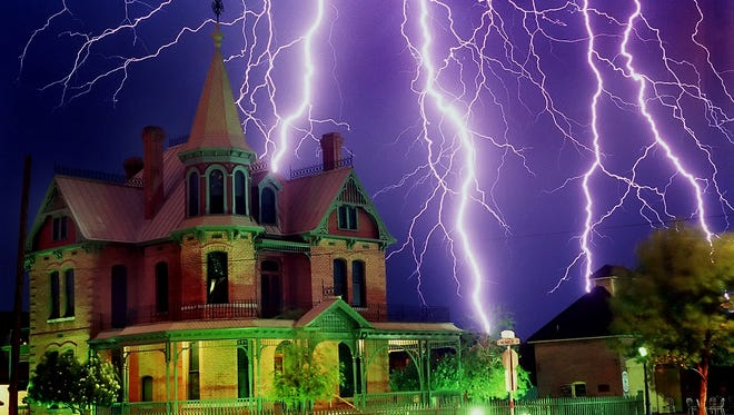 Lightning strikes over the historic Rosson House in downtown Phoenix during a summer monsoon storm.