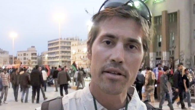 This undated file still image from video released April 7, 2011, by GlobalPost, shows James Foley of Rochester, N.H.