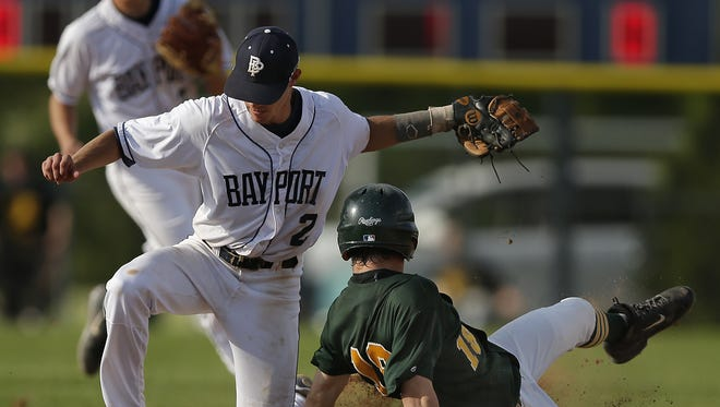 Bay Port infielder Brett Makholm (2) tags out Green Bay Preble's Jarrett Scheelk (18) during a play at second base in Bay Port's 3-2 win on May 24.
