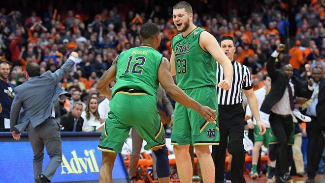 Notre Dame Fighting Irish forward Elijah Burns (12) and forward Martinas Geben (23) react following the game against the Syracuse Orange at the Carrier Dome.